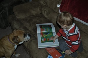 Davey reading to our dog Dixie.