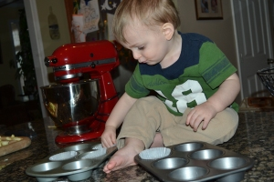Davey lining the muffin pans.