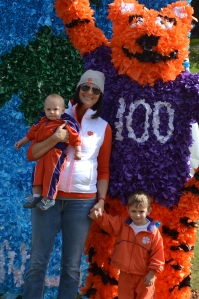 Standing in front of the many floats with my boys.