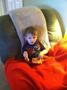 Davey enjoying a morning snack and the movie Star Wars.