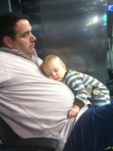 Daddy's make the best pillows especially in an airport.