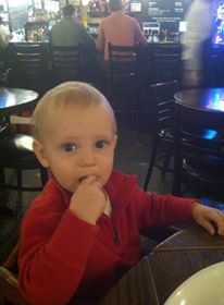 Celebrating his actual 1st birthday eating breakfast at Harry Caray's at Chicago's O'Hare Airport.