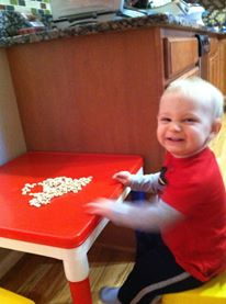 Enjoying a breakfast of cheerios.