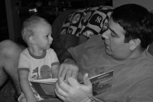 Reading with Daddy when he was 6 months old.