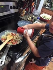 Cooking and seasoning the veggies.