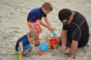 Building a sand castle with daddy.