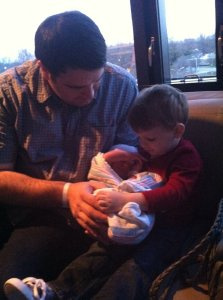Holding his baby brother for the first time.