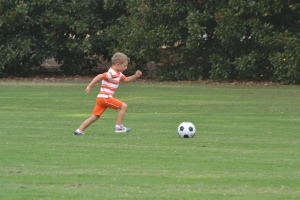 Davey playing soccer on Bowman Field.
