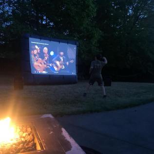 Doing our best to replace the missed concert experience with a pre-recorded Zac Brown Band concert in the backyard.